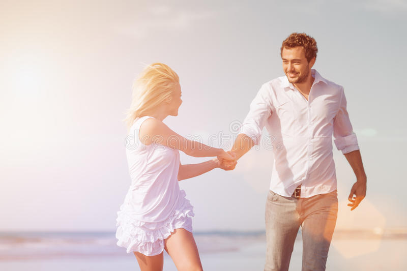 Download Couple On Beach In Honeymoon Vacation Stock Photo - Image of laughing, carefree: 40585744