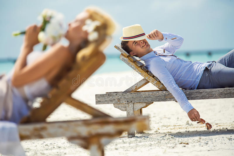 Couple on the beach royalty free stock photo