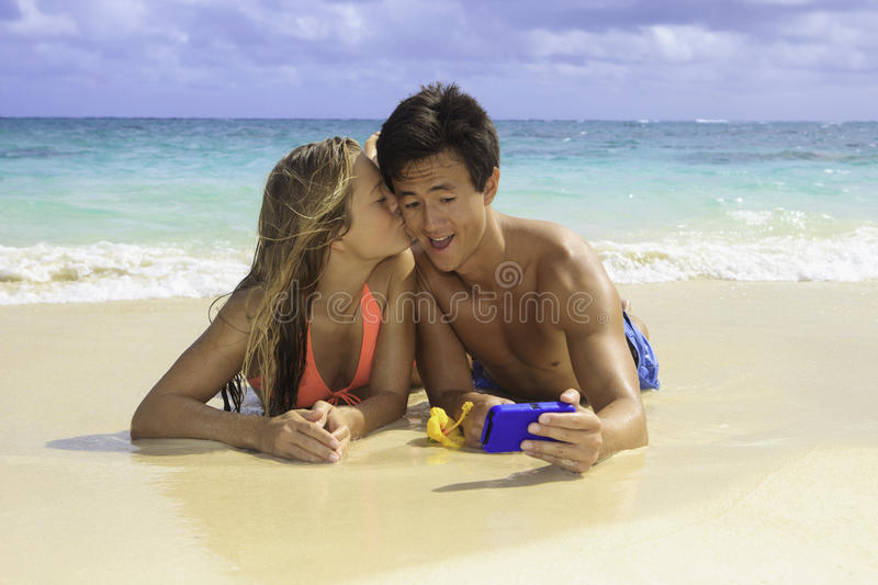 Couple On The Beach Photographing Stock Images