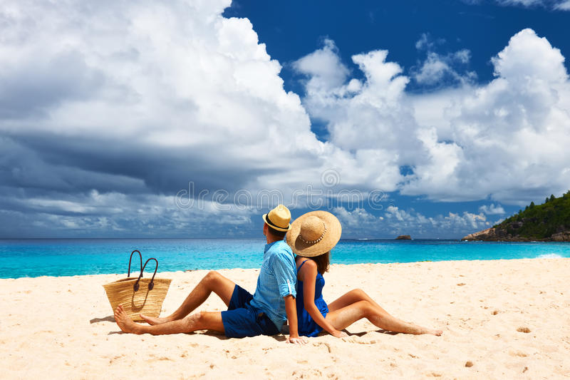 Couple on a beach at Seychelles. Couple relaxing on a tropical beach Anse Intendance at Seychelles, Mahe royalty free stock image