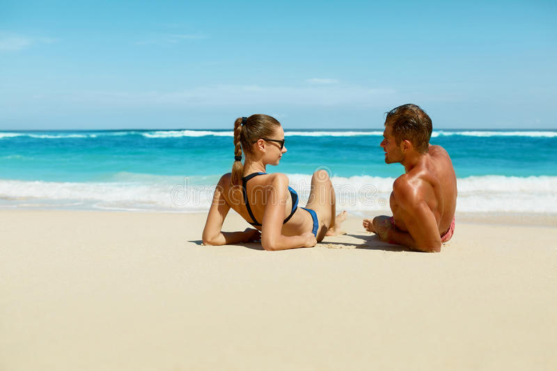 Couple On Beach In Summer. Romantic People On Sand At Resort stock image
