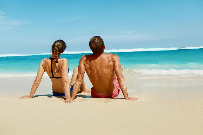 Couple On Beach In Summer. Romantic People On Sand At Resort royalty free stock photos