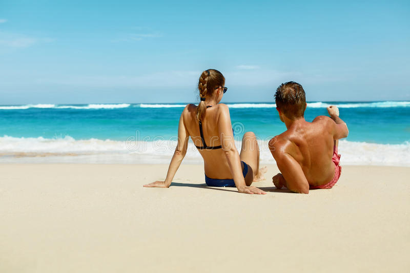 Couple On Beach In Summer. Romantic People On Sand At Resort royalty free stock photo