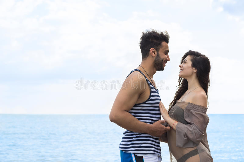Couple On Beach Summer Vacation, Beautiful Young Happy People In Love, Man And Woman Smile Holding Hands. Sea Ocean Holiday Travel royalty free stock images