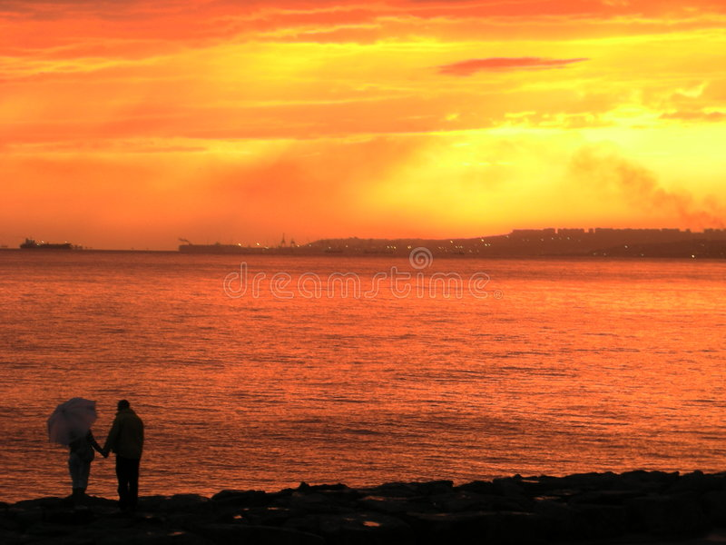 Download Silhouetted Couple On Beach Stock Image - Image: 4262181
