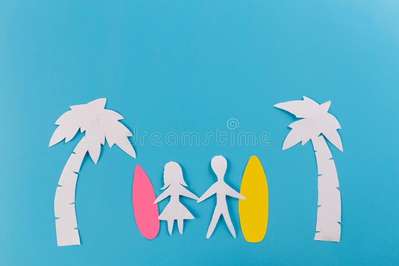 couple on the beach with surfboards stock image