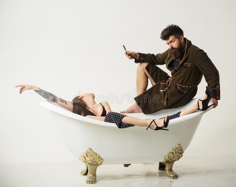 Couple of bearded man and sensual woman in bathroom. Couple enjoy morning routing. Family couple relax in bath. Couple stock photo
