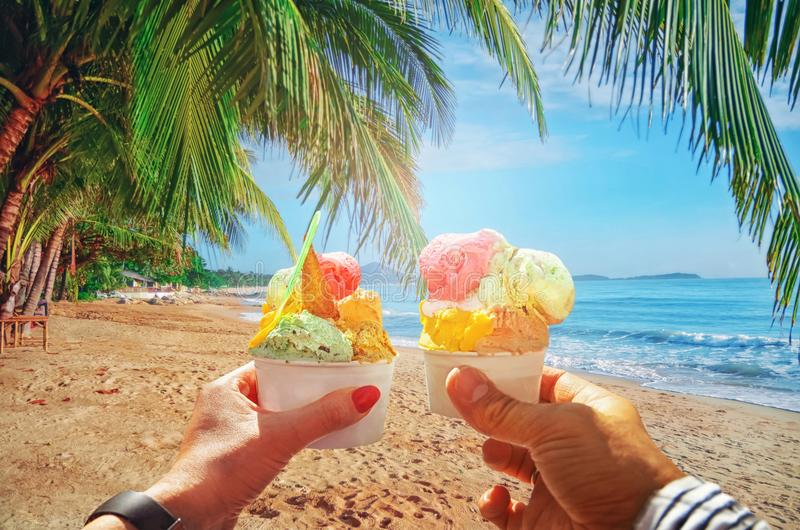 Couple with beautiful bright sweet Italian ice-cream with different flavors in the hands stock photos