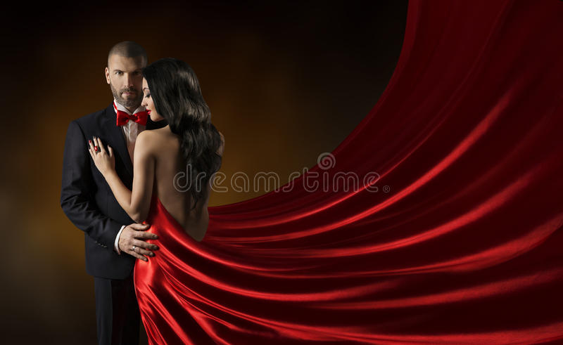 Couple Beauty Portrait, Man in Suit Woman Red Dress, Rich Gown. Couple Beauty Portrait, Man in Suit Woman in Red Dress, Rich Lady in Gown, Waving Silk Fabric
