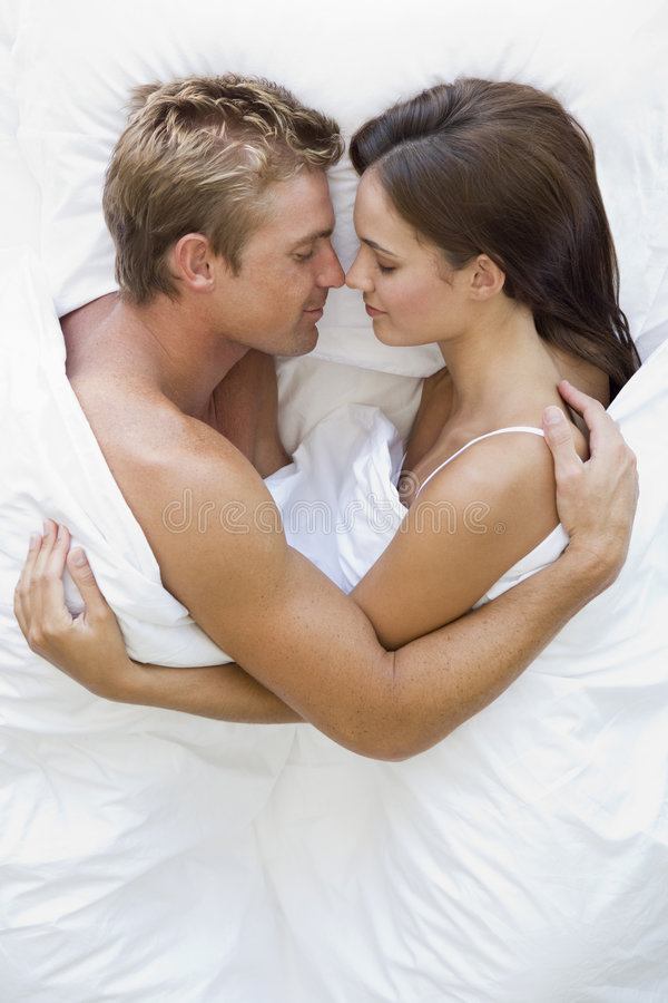 Couple In Bed. Overhead View Of Couple In Bed royalty free stock photography