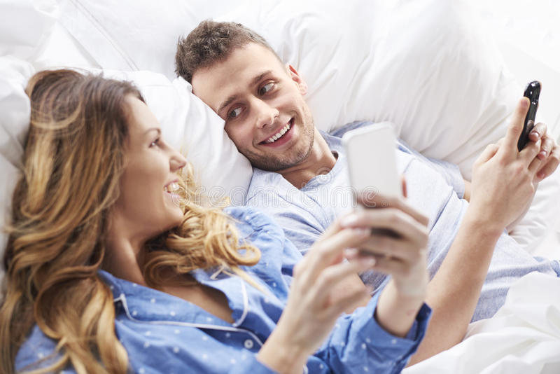 Couple at the bed royalty free stock image