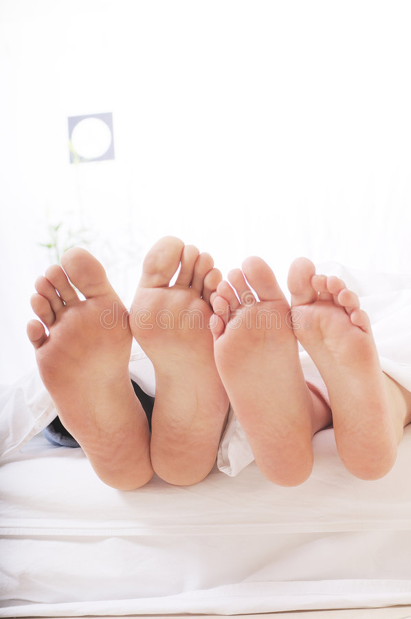 Couple in the bedroom stock image