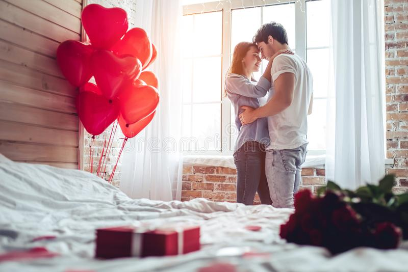 Couple in bedroom royalty free stock photography