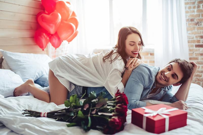 Couple in bedroom stock photos