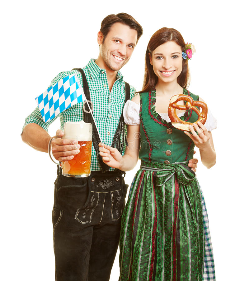 Couple with beer and pretzel at royalty free stock photo