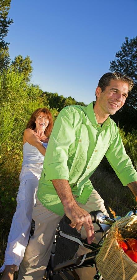Couple on bicycle stock image