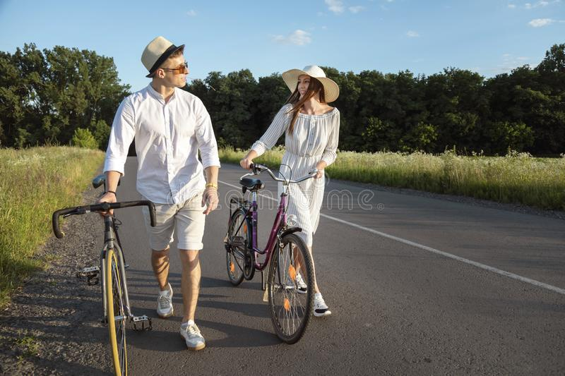Couple of Bicycle Fellow Travelers Chatting royalty free stock photos