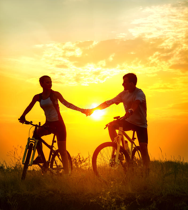 Couple on bicycles stock images