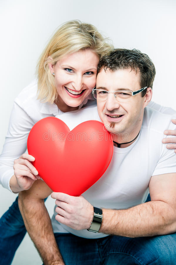 Couple With Big Heart In Their Hands Royalty Free Stock Photos
