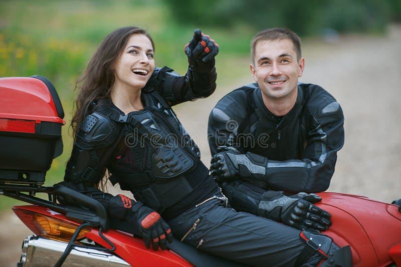 Couple on bike. Young couple on beautiful bike on road royalty free stock image