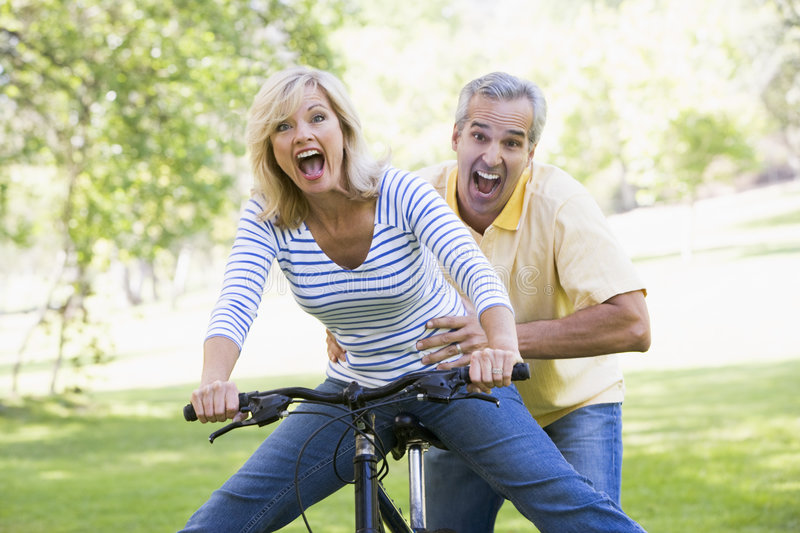 Download Couple On Bike Outdoors Smiling And Acting Scared Stock Photo - Image of horizontal, boyfriend: 5539468