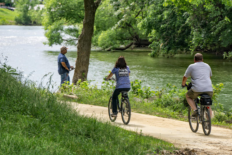 Couple Biking on the Roanoke Valley Greenway stock photo