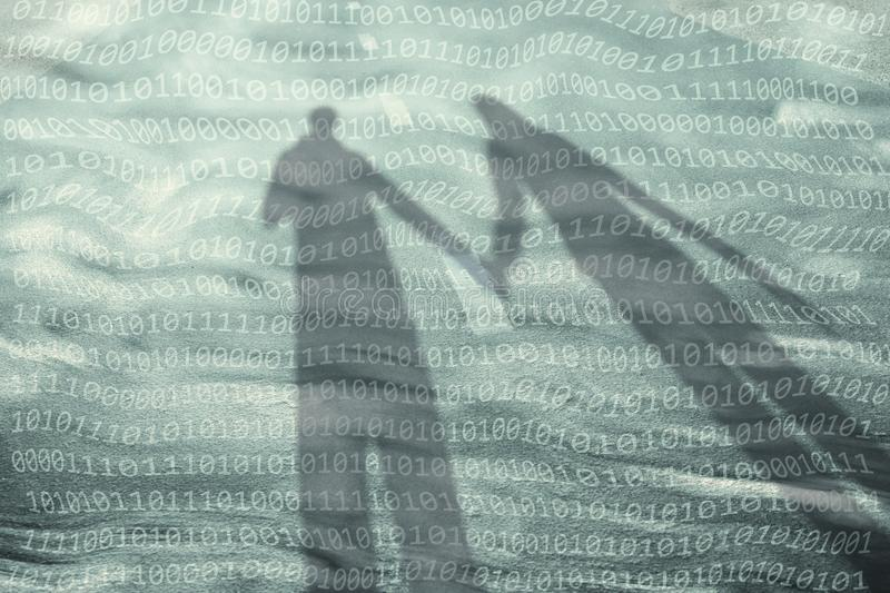Couple with binary number code background royalty free stock photography