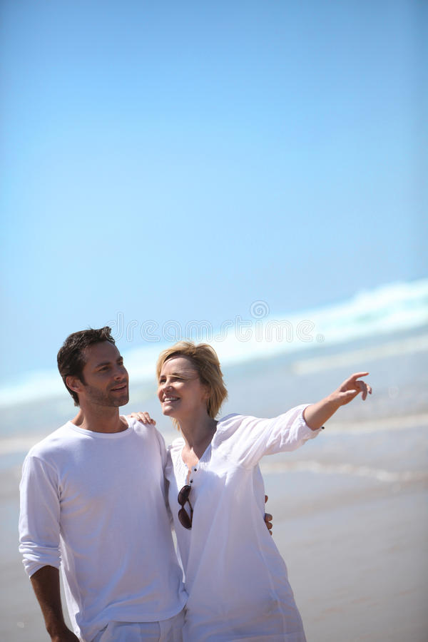 Couple birdwatching by the seaside stock photo