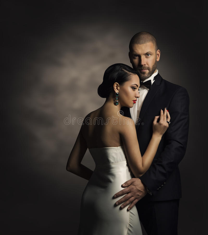 Couple in Black Suit and White Dress, Rich Man and Fashion Woman royalty free stock photo