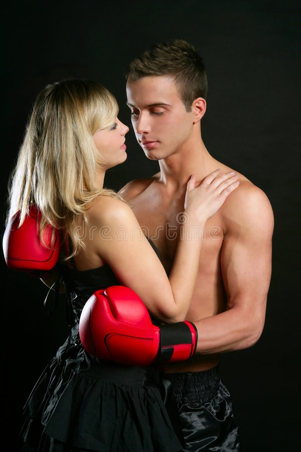 Couple of blond girl and handsome boxer man stock photography