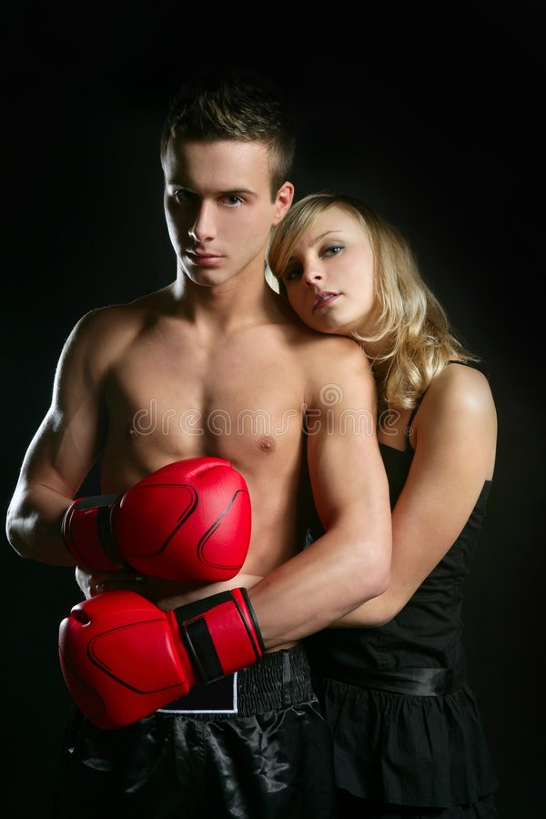 Couple of blond girl and handsome boxer man royalty free stock photos