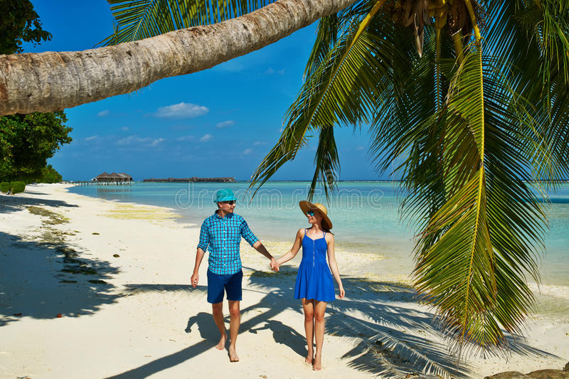 Palm Beach Tan Prices >> Couple In Blue Clothes On A Beach At Maldives Royalty Free Stock Image - Image: 38297486
