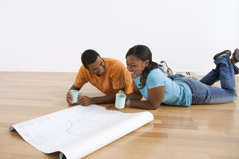 Download Couple with blueprints. stock image. Image of home, communication - 6152251