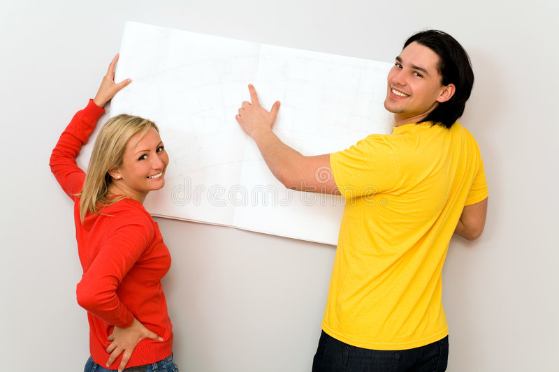 Couple with blueprints stock photos