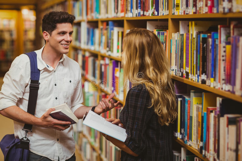 Couple with books looking at each other royalty free stock photo