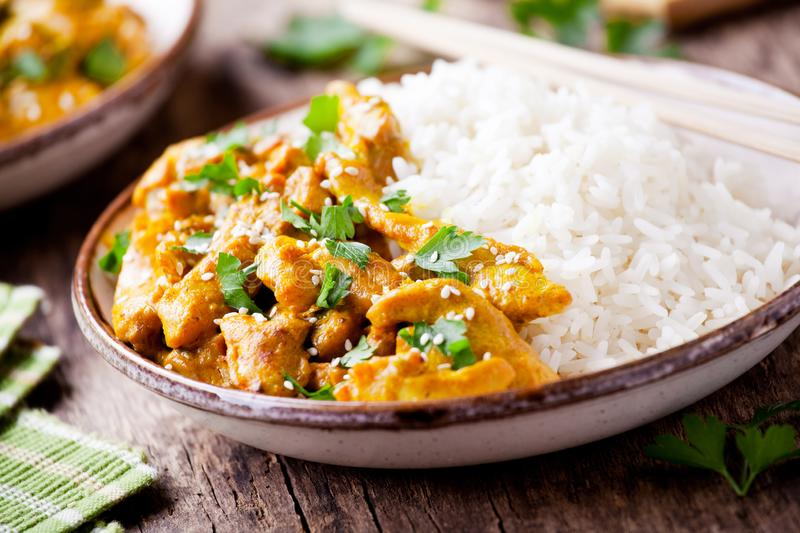 Couple Of Bowls Of Chicken Curry. Couple of bowls of spicy homemade chicken curry royalty free stock image