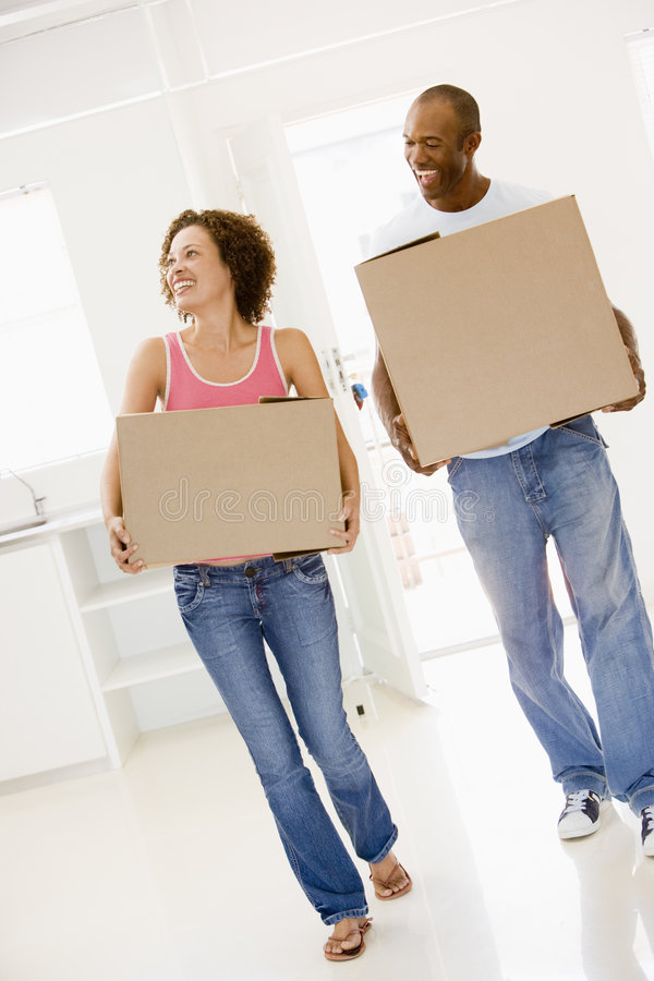 Download Couple With Boxes Moving Into New Home Smiling Stock Image - Image: 5942713