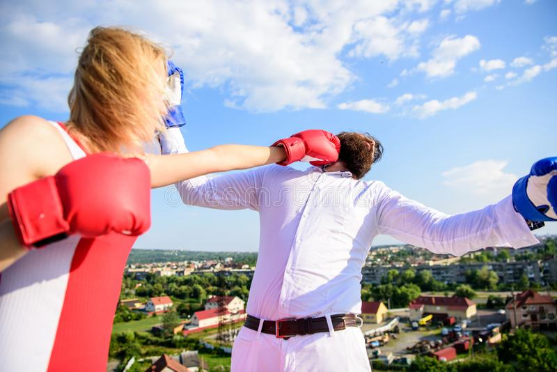 Couple boxing gloves fight sky background. Leadership family relations. Things guy can do to make woman happy. How to. Couple boxing gloves fight sky background royalty free stock photography