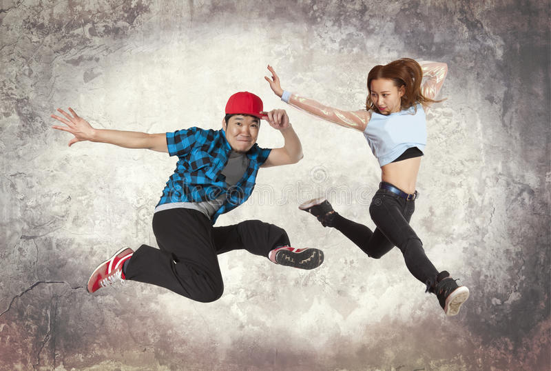 Couple break dancing on wall background royalty free stock image