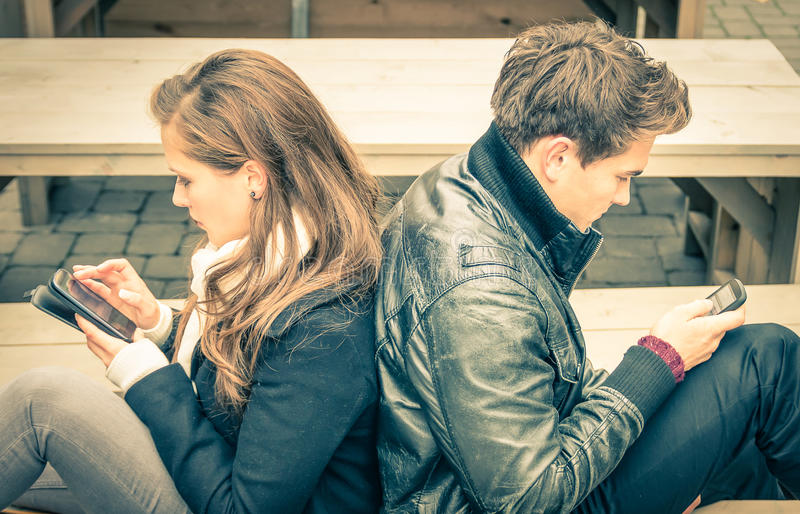 Couple in a break up phase of mutual disinterest stock photos