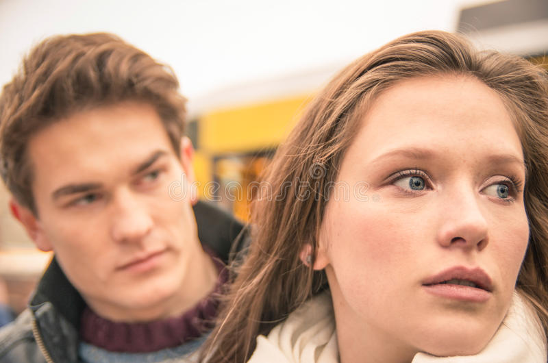 Couple during break up - Sad young woman royalty free stock photography
