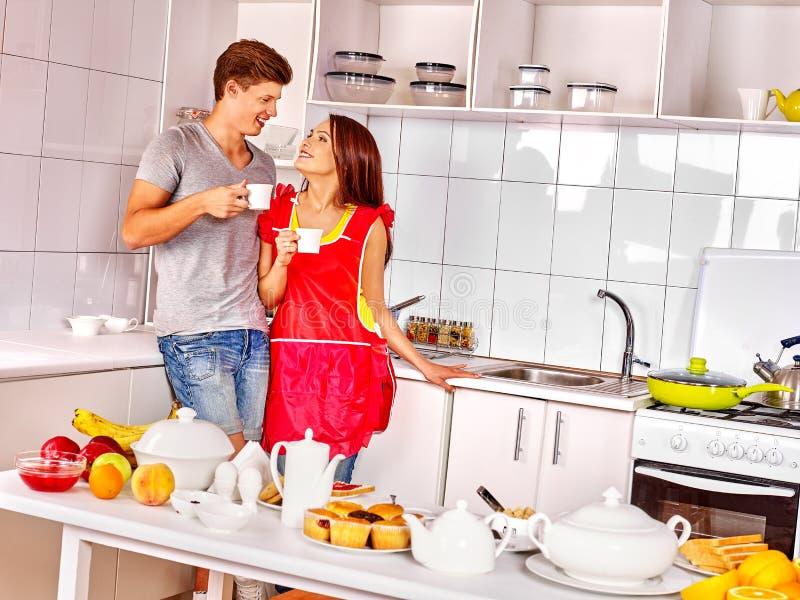 Couple breakfast at kitchen. Happy couple breakfast of cup of tea at kitchen stock photo