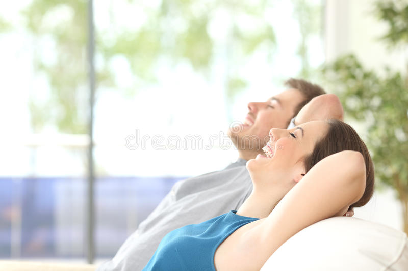 Couple breathing and resting at home stock images