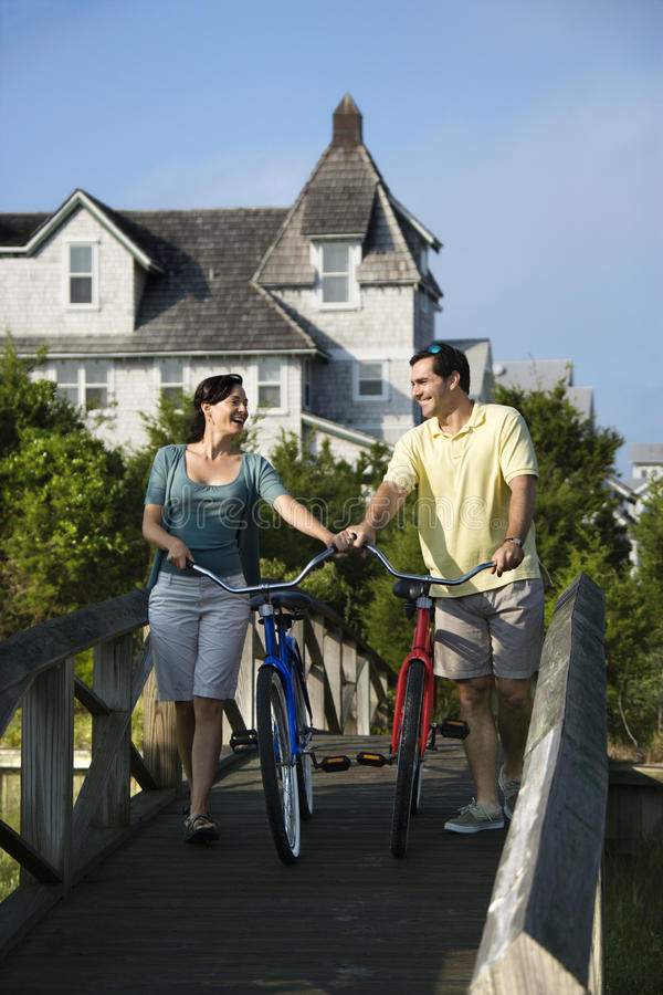 Couple on Bridge with Bicycles stock photo