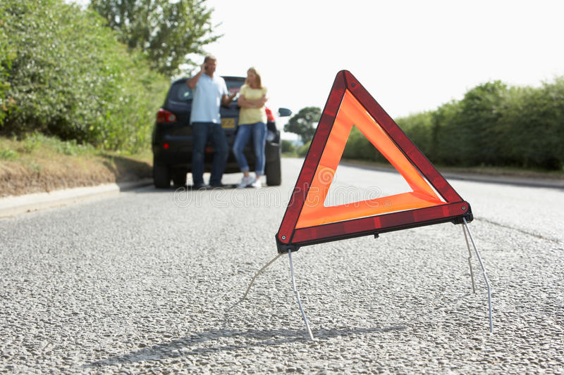 Couple Broken Down On Country Road Royalty Free Stock Photography