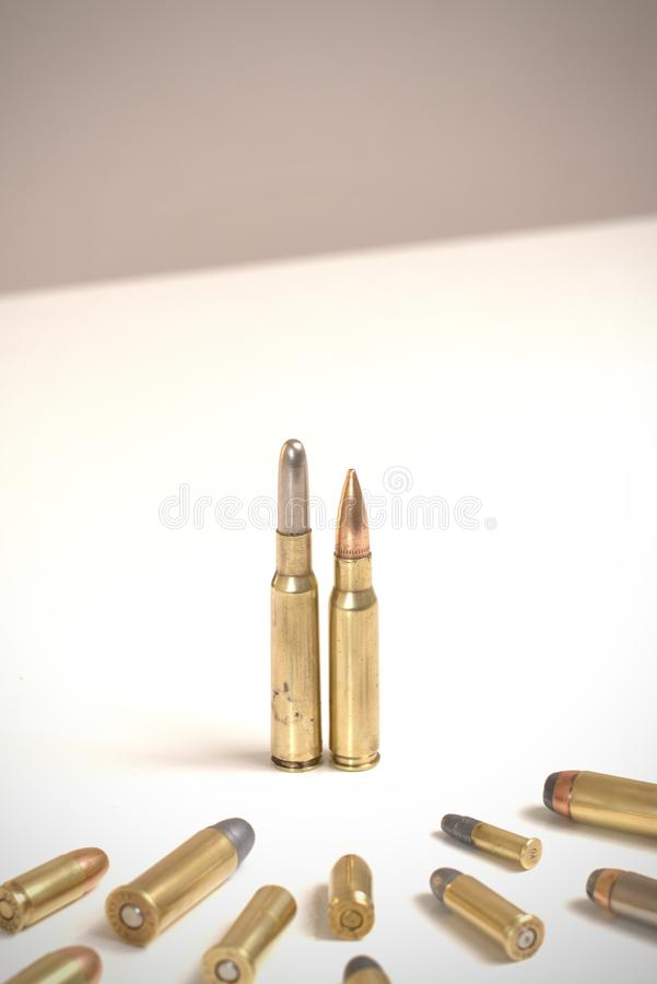 A couple of bullets standing in front of several other bullets of various calibers. It works as a concept for power, obedience, do. Mination, dictatorship.nnThe stock images
