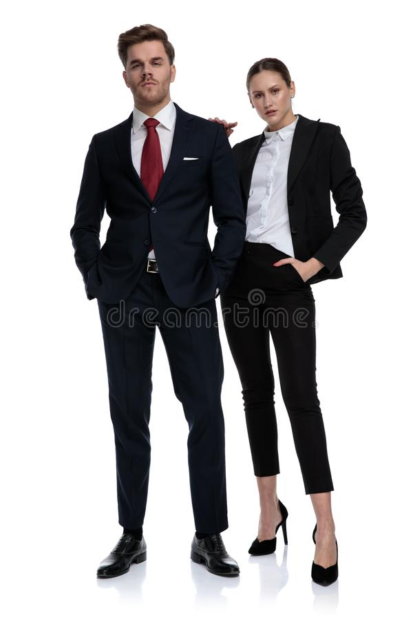 Couple in business suits looking serious royalty free stock photo