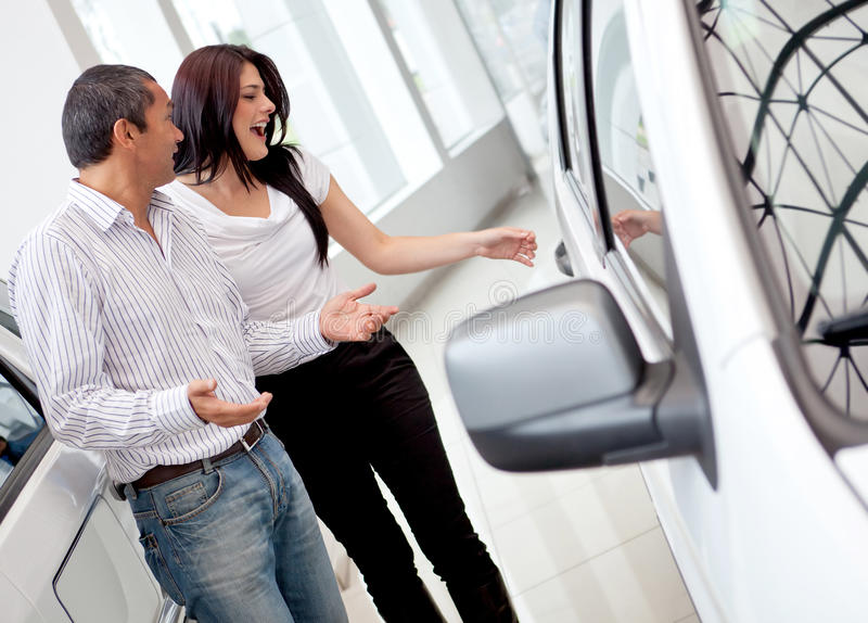 Download Couple buying a car stock photo. Image of sale, girls - 23733162