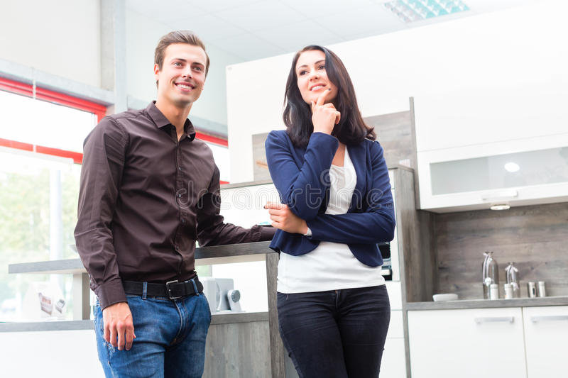 Couple buying domestic kitchen furniture store. Man and women buying domestic kitchen in studio or furniture store stock photos