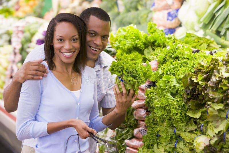 Couple buying fresh produce stock photography